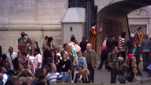 VATICAN CITY - MAY 2012 Tourists watched by the Swiss Guard on May 8, 2012, in R Live Action