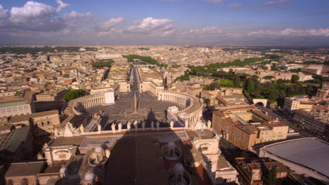 Aerial pan of St. Peter's plaza and the rooftops of Rome Footage