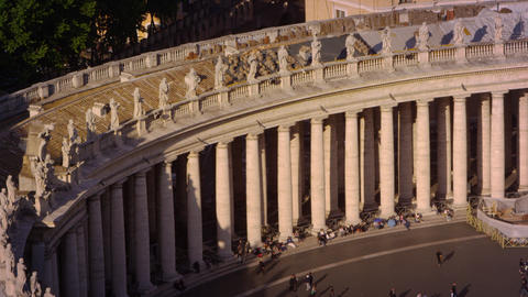Tourists among row of columns lining the piazza of St Peter's Basilica Footage