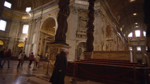 VATICAN CITY - MAY 2012 Monk walks to Bernini's Baldacchino on May 8, 2012, in R Footage