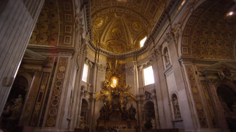 Tilt up from pews to ceiling of St Peter's Basilica Footage