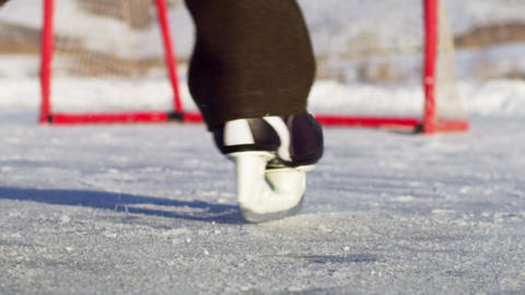 Close-up of an outdoor ice rink, hockey net, and skates Footage