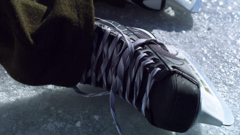 Close up of a hockey skate at an outdoor rink Footage