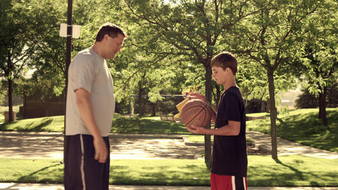 Royalty Free Stock Footage of Dad and son playing basketball Live Action