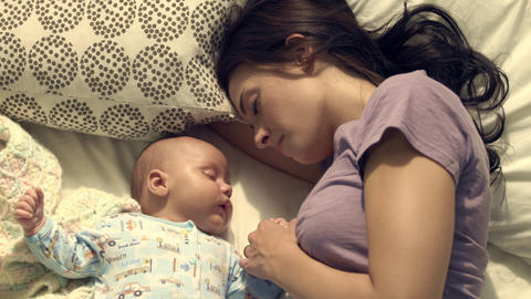 Royalty Free Stock Footage of Mother and baby taking a nap together Footage