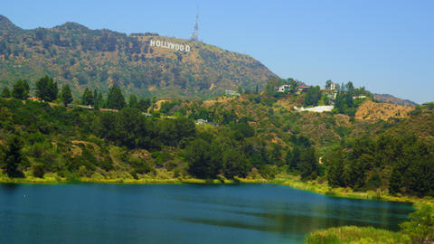 Pan of reservoir, hills bearing Hollywood sign, houses Footage
