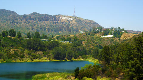 Static shot of reservoir, hills bearing Hollywood sign, houses Footage