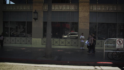 Slow motion dolly shot of buildings along Hollywood Blvd. in California Footage