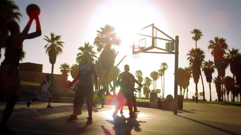 Slow motion basketball game with lens flare shot near Venice Beach, California Footage