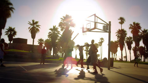 Basketball game in slow motion with lens flare shot near Venice Beach, Californi Footage