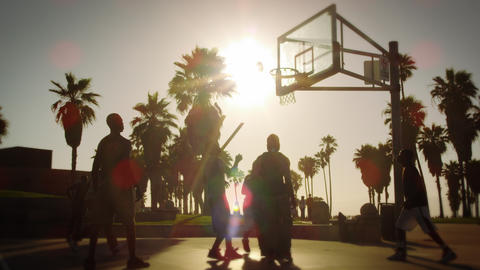 Lens flare shot of basketball game near Venice Beach, California filmed at varyi Footage