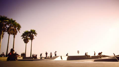 Slow motion shot of jumping skateboarder at Ocean Front Walk near Venice Beach,  Footage