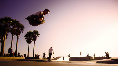 Slow motion shot of jumping rollerblader at Ocean Front Walk near Venice Beach,  Footage