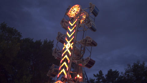 Shot of moving carnival ride at dusk Footage