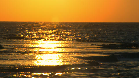 Royalty Free Stock Video Footage of a sunset reflection at Dor Beach shot in Isr Footage