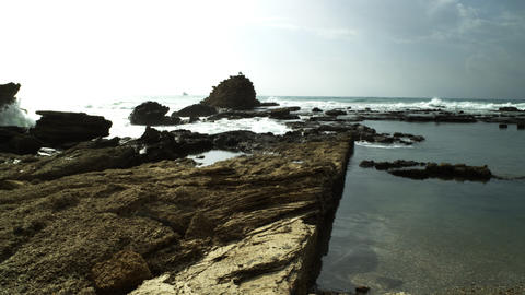 Stock Video Footage of ancient pool ruins on the Israeli seashore shot in Israel Footage