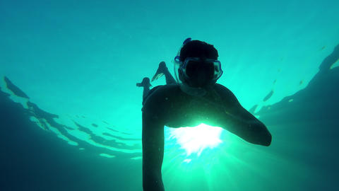 Young man diving and swimming back to the surface Footage