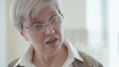 Portrait of attractive mature woman in glasses with emotion of misunderstanding Footage