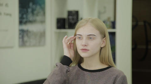 Portrait of a beautiful girl with framed eyebrows for coloring in a beauty salon Footage