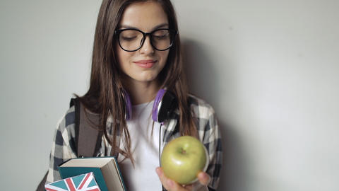 Girl Holding Great Britain's Flag, Book and an Apple Live Action
