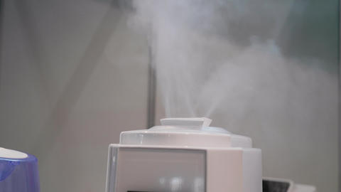 Humidifier spreading steam with a lot of vapor volume indoor Stock Video Footage