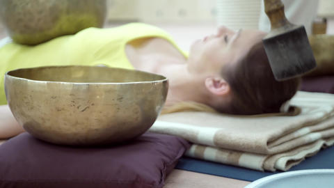 Woman practicing yoga meditation with singing bowl Footage