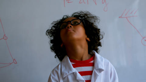 Pretty African-American schoolboy standing in laboratory at school 4k Live Action