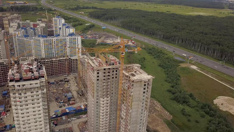 Aerial day fly over under construction new modern building work builders and Footage