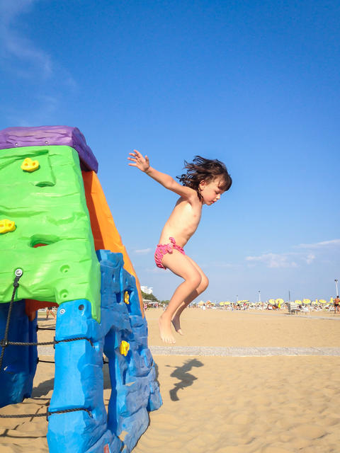 The little girl, jump from a colorful toy house Fotografía