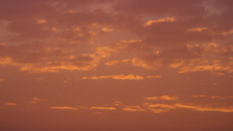 Royalty Free Stock Video Footage of orange clouds at sunset shot in Israel at 4k Footage