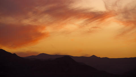 Royalty Free Stock Video Footage of wispy orange clouds at sunset shot in Israel Footage