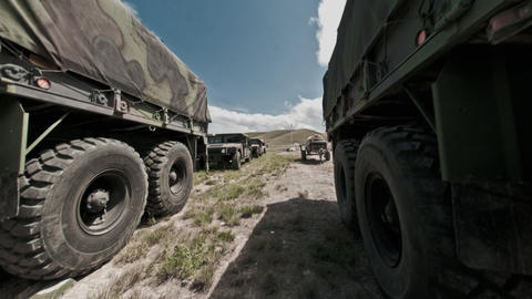 Time-lapse filmed between military convoy trucks Footage