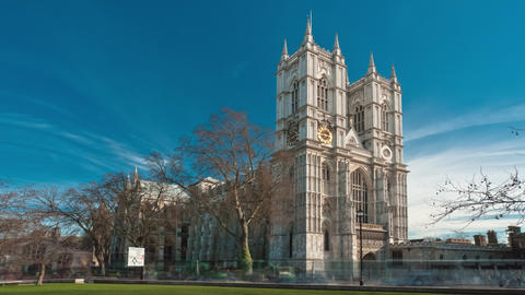 Time-lapse of Westminster Abbey under a blue sky in London Footage