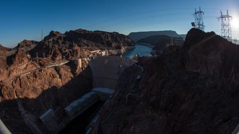 Timelapse shot of the sunrise over the Hoover Dam in Nevada with lens flare Footage