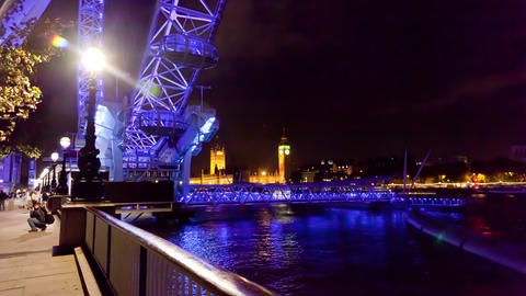 Time-lapse of the London Eye and Big Ben at night Footage