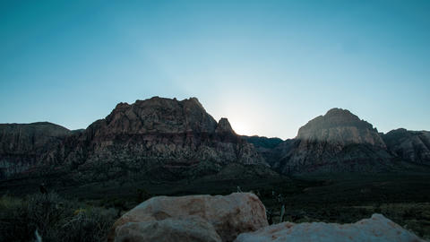 Timelapse shot of the sun rising over the mountains at the Nevada desert with le Footage
