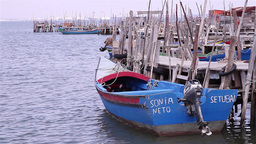 Fishing boat in old harbor made of wooden stakes Footage