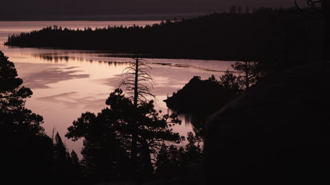 Static shot of a Emerald Bay, Lake Tahoe, California at sunset with silhouetted  Footage