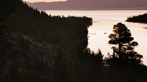 Static shot of a cliff overlooking Lake Tahoe at sunset Footage