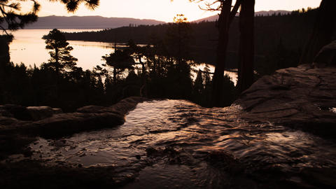 Silhouette shot of a running stream shot at sunset near Lake Tahoe Footage