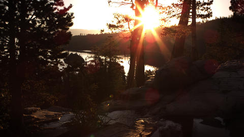 Dusk shot of stream with sunbeam in background above Emerald Bay, Lake Tahoe, Ca Footage