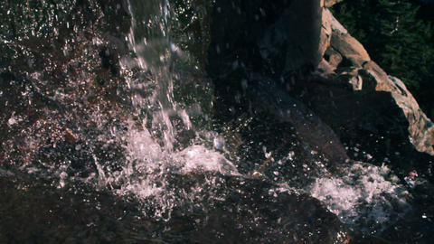 Slow motion closeup shot of waterfall splashing Footage