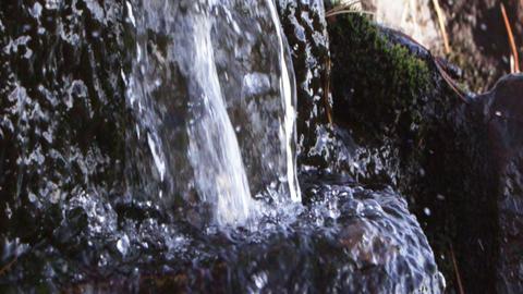 Closeup slow motion water fall splashing as it hits rock Footage