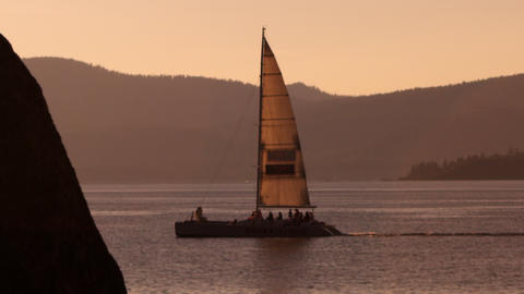 Static shot of sailboat at dusk. Shot at Emerald Bay State Park, Lake Tahoe, Cal Footage