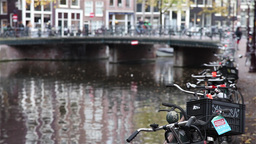 Bicycles parked on the bridge over a Amsterdam canal Footage