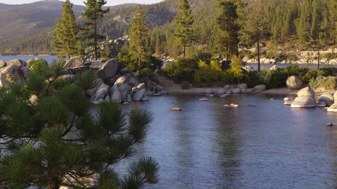 Static shot of Emerald Bay at Lake Tahoe, California, surrounded by rocks and tr Footage
