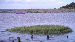 Small boat anchored in a bay, slider shot Footage