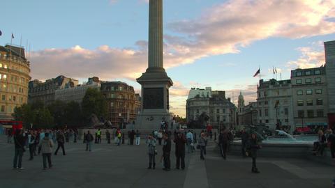 LONDON - OCTOBER 7: Tourists near Nelson's Column in Trafalgar Square at sundown Footage