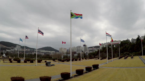 South African Flag Waving in the air of UN Memorial Cemetery in Busan, South Korea, Asia Live Action