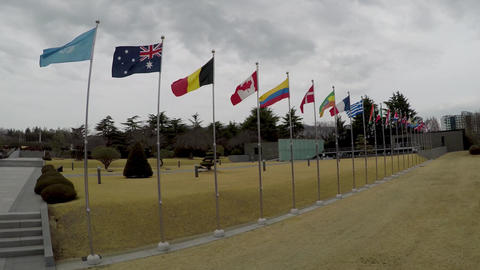 United Nations and National Flag Waving in the air of UN Memorial Cemetery in Busan, South Korea, Footage